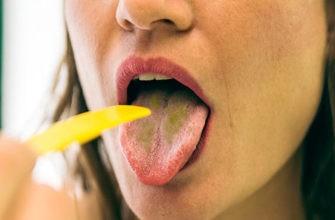 Причины зеленого налета на языке